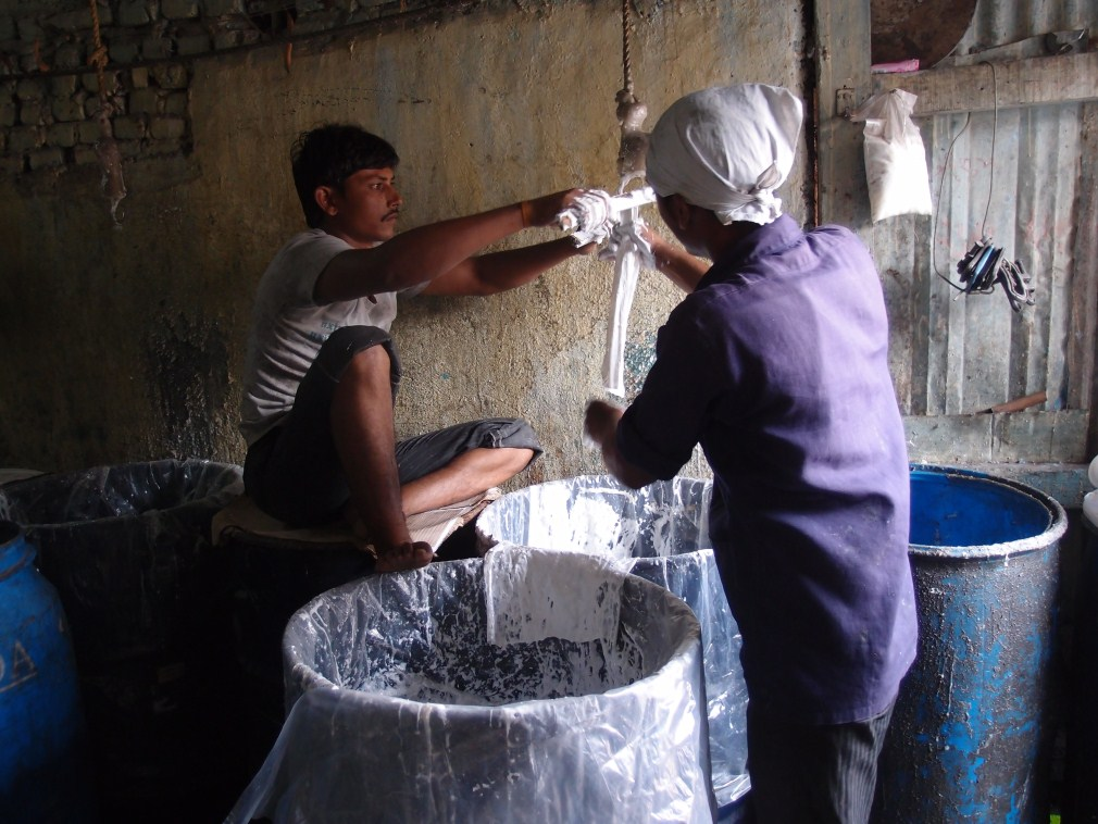Glue being recycled in the slum