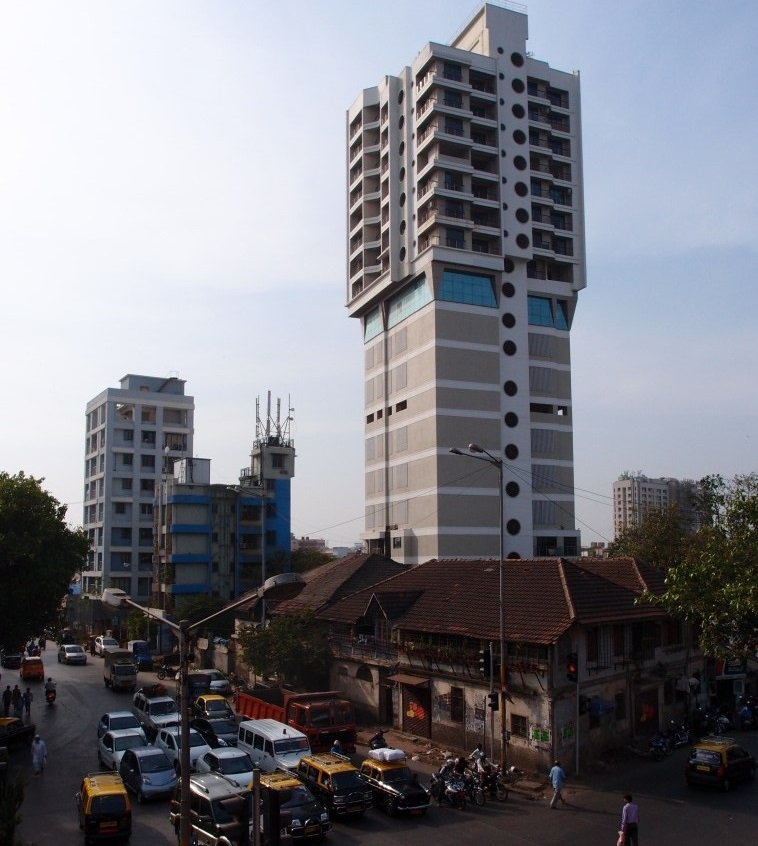 Right next to the slum: Modern buildings